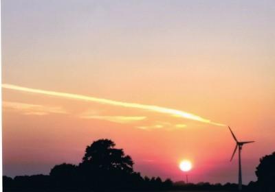 Sun Sets On Wind Turbine
