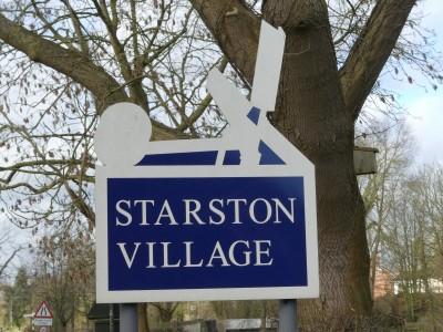 Village-wind-pump-sign